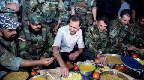 tong thong syria bashar al-assad ngoi an cung cac binh si saa tai mat tran phia dong gouta